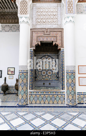 Intricately patterned ceramic tiles on walls and floor of the Museum of Marrakech, Morocco - Stock Photo