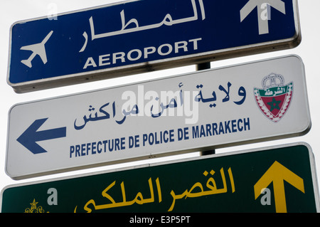Signs for the Prefecture De Police de Marrakech, police station, and the Aeroport Menara International Airport, - Stock Photo