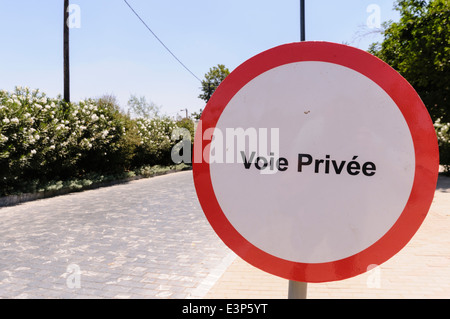 Sign saying 'Voie Privée' (private road), Morocco - Stock Photo