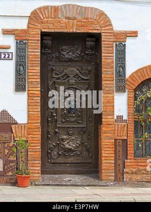 Santo Domingo de la Calzada, La Rioja, Spain. Carved wooden door in the old town. - Stock Photo