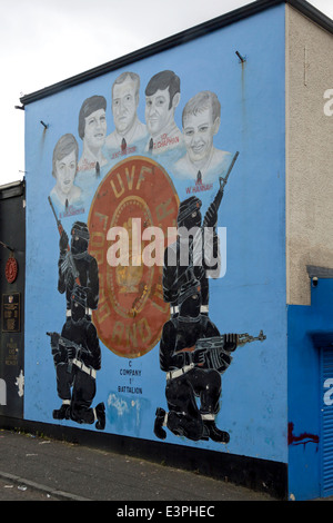 An Ulster Volunteer Force Mural in the Loyalist area of West Belfast showing the UVF, with hooded paramilitaries - Stock Photo