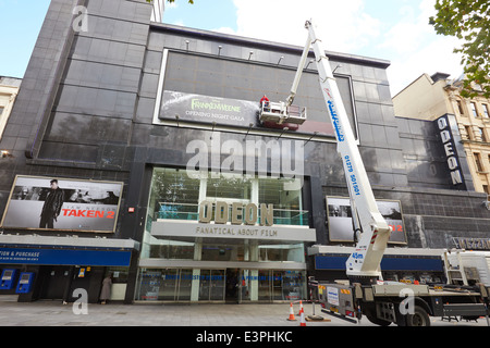 Crane being used to prepare for a film premier at the Odeon cinema in Leicester Square - Stock Photo
