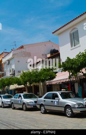 Taxis by harbour, Logotheti street, Pythagoreio, Samos, Aegean Sea, Greece, Europe - Stock Photo