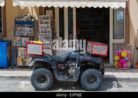 Delivery quadbike outside a supermarket Logotheti street, Pythagoreio, Samos, Aegean Sea, Greece, Europe - Stock Photo