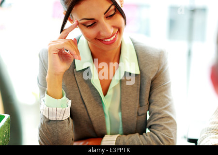 Portrait of a cheerful businesswoman in office - Stock Photo