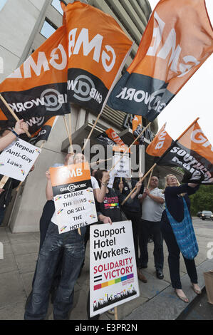June 27, 2014 - London, UK - The GMB union and LGBT activists protest outside 45 Park Lane hotel in London. The - Stock Photo