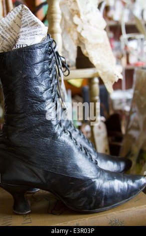 Womans leather lace up shoe Antiques and old items in store in Leadville Colorado - Stock Photo