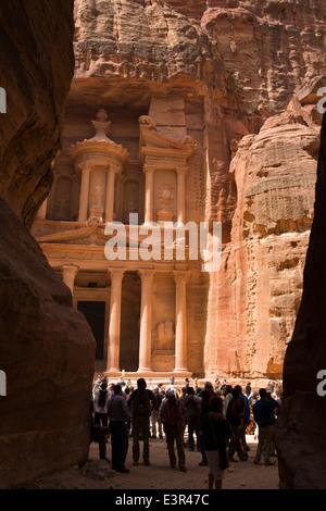 Jordan, Arabah, Petra, first view of the Treasury, Khazneh Al Firaun from Al-Siq entrance canyon to site - Stock Photo