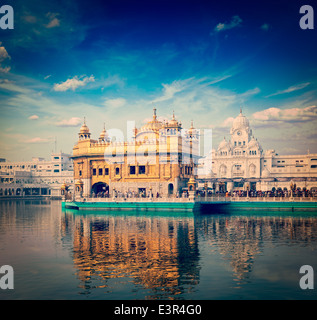 Vintage retro hipster style travel image of famous India attraction Sikh gurdwara Golden Temple (Harmandir Sahib). - Stock Photo