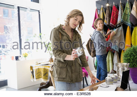 Couple looking at home decor in shop - Stock Photo