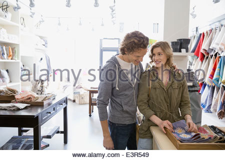 Couple looking at fabric in shop - Stock Photo