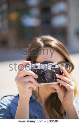 Close up of woman using camera - Stock Photo