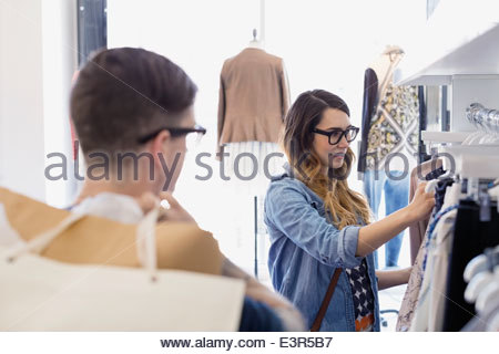 Couple shopping in clothing store - Stock Photo