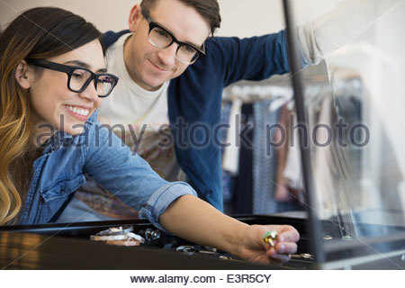 Couple looking at jewelry in shop - Stock Photo