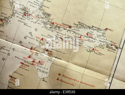 Ancient yellow Russian navigational map fragment with red labels - Stock Photo