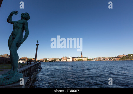 Song Statue in front of the City Hall,  Column with statue of Engelbrekt Engelbrektsson  and Gamla Stan - Stock Photo