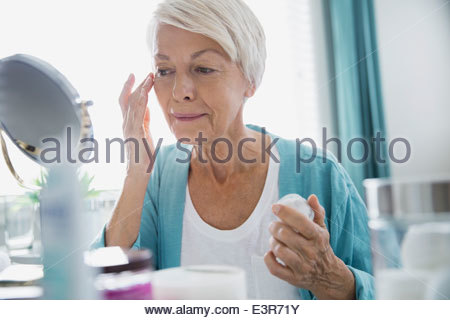 Woman applying wrinkle cream - Stock Photo