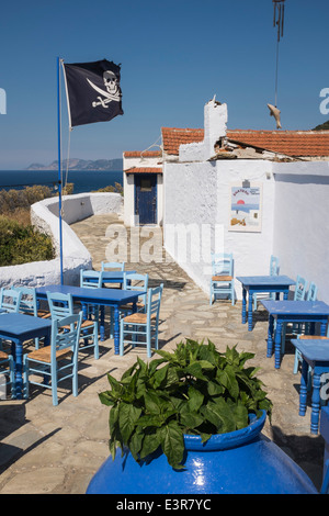 The Jolly Roger flies above the taverna at the Kastro in Skopelos town. - Stock Photo