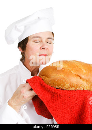 Chef baker smelling fresh baked bread. Isolated on white.  - Stock Photo