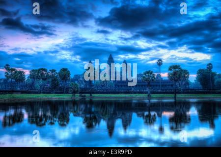 High dynamic range (hdr) image of Angkor Wat - famous Cambodian landmark - on sunrise. Siem Reap, Cambodia - Stock Photo