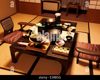 Dinner on a table at a Japanese traditional ryokan hotel room in Gero, Gifu, Japan. - Stock Photo