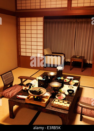 Dinner served on a table at a Japanese traditional ryokan hotel room in Gero, Gifu, Japan. - Stock Photo