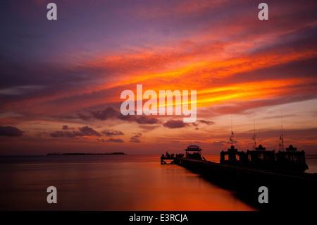 Sunset over the Flores Sea, Wakatobi, Indonesia - Stock Photo