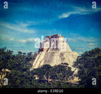 Vintage retro hipster style image of Anicent mayan pyramid (Pyramid of the Magician, Adivino) in Uxmal, Merida, - Stock Photo