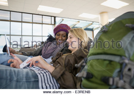 Smiling women waiting in airport - Stock Photo