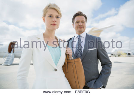 Portrait of confident business people on tarmac - Stock Photo