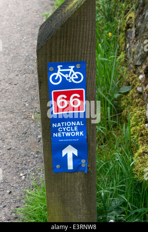 National Cycle Network signpost on the canal towpath near Luddenden Foot, West Yorkshire - Stock Photo