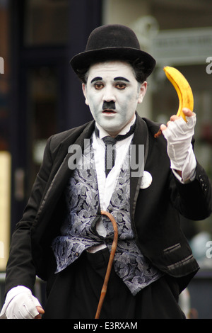 Street entertainer, Diego Andres Spano performs as Charlie Chaplin at Ashbourne International Street Festival, Derbyshire, - Stock Photo