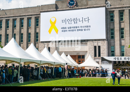 Mourners gather outside of Seoul City Hall on May 6, 2014 to pay their respects to victims of the Sewol ferry tragedy. - Stock Photo