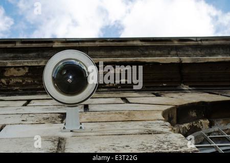 Hi-tech dome type camera and a blue sky - Stock Photo