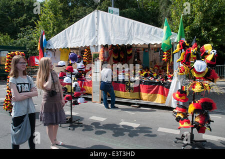 Berlin, Germany. 27th June, 2014. Souvenir sellers prepare for 2014 FIFA World Cup live broadcasts at the Brandenburg - Stock Photo