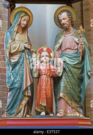 BRUGGE, BELGIUM - JUNE 13, 2014: Carved satues of Holy Family from 19. cent. in st. Giles (Sint Gilliskerk). - Stock Photo