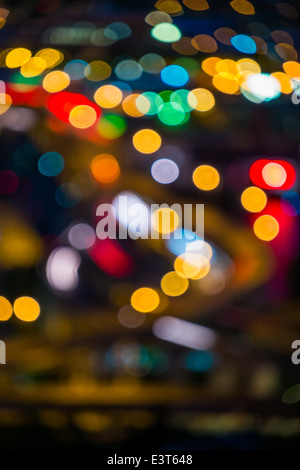 Portland, Oregon downtown city lights, out of focus, at night - Stock Photo