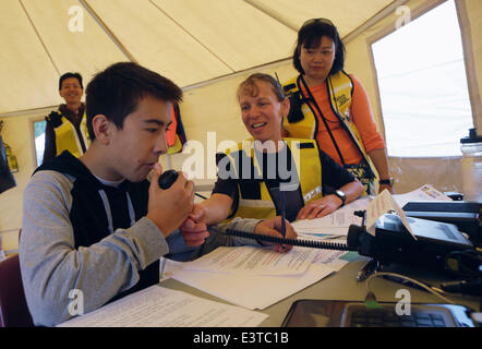 Vancouver, Canada. 28th June, 2014. A young resident learns how to operate an radio equipment during the annual - Stock Photo