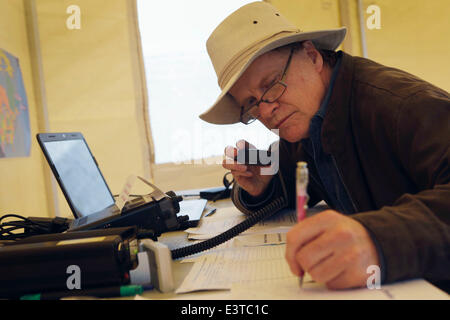 Vancouver, Canada. 28th June, 2014. An amateur radio operator works on the radio equipment during the annual radio - Stock Photo
