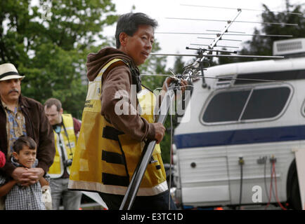 Vancouver, Canada. 28th June, 2014. An amateur radio operator adjusts the antenna angle for better signal reception - Stock Photo