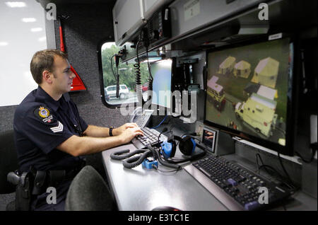 Vancouver, Canada. 28th June, 2014. A lcoal Vancouver policeman participates in the annual radio field day exercise, - Stock Photo
