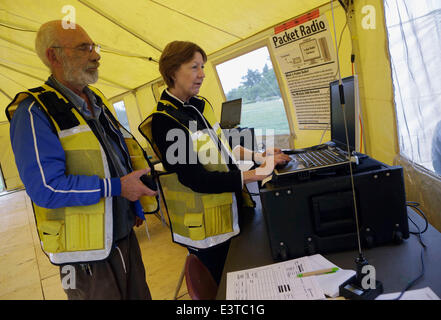 Vancouver, Canada. 28th June, 2014. Amateur radio operators transmit E-mails and digital signal via radio frequency - Stock Photo