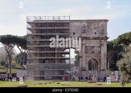 Rome, Italy- April 02, 2014:Tourists visiting the triumphal arch of Titus (81 AD) - Stock Photo