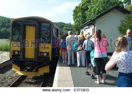 Looe Valley Line - passengers waiting to board the train at the end of the day, at Looe railway station in Cornwall, - Stock Photo