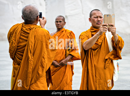 Thai Buddhist monks take camera phone photos of their visit to the Martin Luther King Jr. Memorial June 19, 2014 - Stock Photo