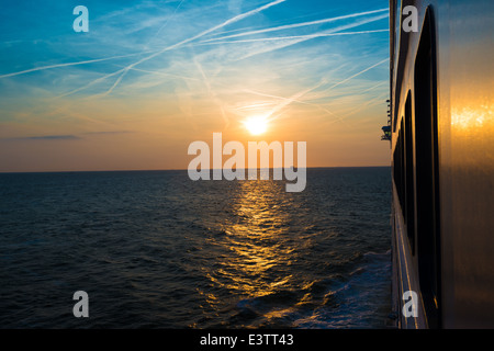Sunset from a luxury cruise liner - Stock Photo