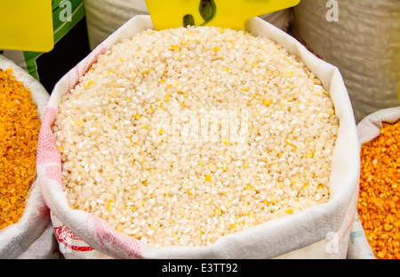 Cracked Corn Kernels In A Sack - Stock Photo