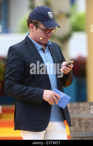 Stefan Mross looks at his smartphone during the final rehearsal for the Germantelevision show 'Immer wieder sonntags' - Stock Photo