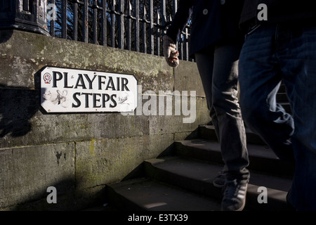A couple walks at Playfair Steps in Edinburgh, Scotland - Stock Photo