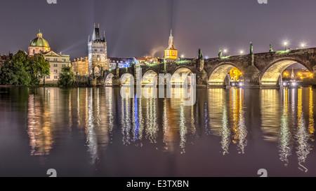 Charles bridge in Prague at night, Czech Republic. Hdr image. - Stock Photo